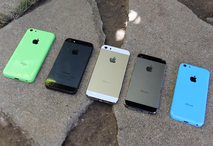 Apple's iPhone 5 side-by-side with bright colored new iPhone 5C models